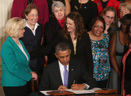 President Barack Obama, signing an executive order in April enforcing equal pay for federal contractors with Lilly Ledbetter on his left, has not done significantly better in hiring women in his own administration. (Mark Wilson/Getty Images)