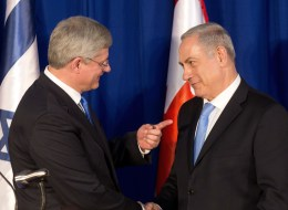 Israeli Prime Minister Benjamin Netanyahu (R) and Canadian Prime Minister Stephen Harper shake hands during a press conference following their meeting in Jerusalem, on January 21, 2014.  (Getty)