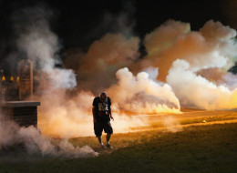 Ferguson police have been shooting tear gas at protesters. (Photo by Scott Olson/Getty Images)