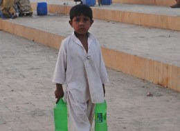 A Pakistani child sells beverages on a beach in Karachi on March 21, 2012 on the eve of the UN World Water Day.