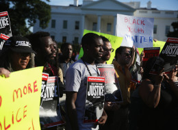 Activists brought over 900,000 petitions to the White House gates on Thursday. (Alex Wong/Getty Images)