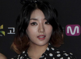 This July 24, 2014 photo, shows Go Eun-bi, a member of South Korean group Ladies' Code, during a photo call to celebrate the 10th anniversary of Mnet M Countdown in Goyang, South Korea. Go Eun-bi, better known as EunB, died after a van carrying the pop group crashed into a guard rail on a rain-drenched highway near Seoul, police said Thursday, Sept. 4, 2014. (AP Photo/Ahn Young-joon)