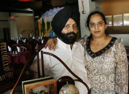 Rana Singh Sodhi, left, and his wife Sukhbir Kaur stand inside the family restaurant, as the two talk about the loss of Rana's brother, Balbir Singh Sodhi, a Sikh immigrant who was fatally shot in the post-Sept. 11 backlash, and the new PBS documentary film,