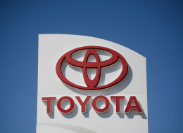 A sign stands outside Hiland Toyota dealership in Moline, Illinois, U.S., on Wednesday, April 9, 2014. Toyota Motor Corp., the world's largest carmaker, called back more than 6 million vehicles to fix a range of safety defects in one of the biggest recalls in automotive history. Photographer: Daniel Acker/Bloomberg via Getty Images