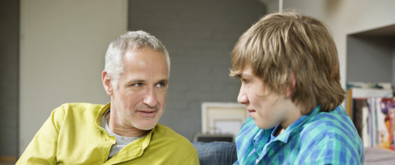MAN TALKING TO TEENAGER