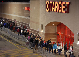Shoppers head into Target just after thei doors opened at midnight on Black Friday, Nov. 28, 2014, in South Portland, Maine. (AP Photo/Robert F. Bukaty)