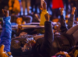 WASHINGTON, DC - DECEMBER 5 :  Protesters demonstrate on the streets of Washington during a protest after two grand juries decided not to indict the police officers involved in the deaths of Michael Brown in Ferguson, Mo. and Eric Garner in New York, N.Y. in Washington, D.C. on December 5, 2014. (Photo by Samuel Corum/Anadolu Agency/Getty Images)