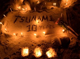Candles on a sand sculpture are seen during commemorations on the the tenth anniversary of the 2004 tsunami at Patong beach in Phuket province on December 26, 2014. In the morning of December 26, 2004 a 9.3-magnitude earthquake off Indonesia's western coast generated a series of massive waves that killed more than 220,000 people across 14 countries as far apart as Indonesia, Sri Lanka and Somalia. AFP PHOTO/Pornchai KITTIWONGSAKUL (Photo credit should read PORNCHAI KITTIWONGSAKUL/AFP/Gett
