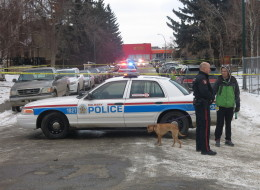 Calgary Police cordon off a street in southwest Calgary after several people were wounded at a house party on Thursday, Jan. 1, 2015
