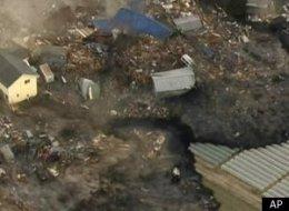 Devastation shown from a tsunami following the Japan earthquake