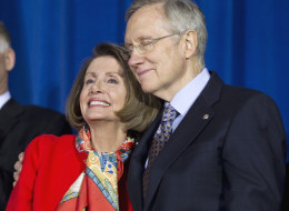 Senate Majority Leader Harry Reid of Nev., right, hugs House Speaker Nancy Pelosi of Calif., during a signing ceremony for