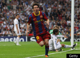 MADRID, SPAIN - APRIL 27: Lionel Messi of Barcelona celebrates after scoring his first goal during the UEFA Champions League Semi Final first leg match between Real Madrid and Barcelona at Estadio Santiago Bernabeu on April 27, 2011 in Madrid, Spain. (Photo by Alex Livesey/Getty Images)