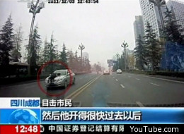 A Chinese policeman clung onto the bonnet of an illegal taxi at speeds of over 90mph as the driver tried to escape