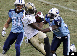 New Orleans Saints wide receiver Marques Colston (12) scores his second touchdown of the game on a 28-yard pass play as he is defended by Tennessee Titans cornerback Cortland Finnegan (31) and cornerback Alterraun Verner (20) in the fourth quarter of an NFL football game on Sunday, Dec. 11, 2011, in Nashville, Tenn. The Saints won 22-17. (AP Photo/Joe Howell)