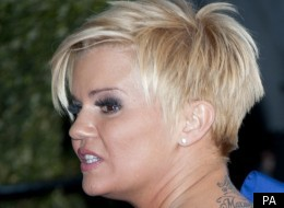 Kerry Katona fights off unwanted attention from female stalker