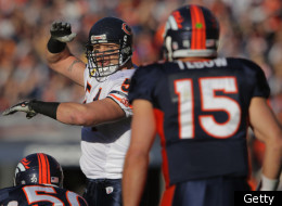DENVER, CO - DECEMBER 11: Linebacker Brian Urlacher #54 of the Chicago Bears runs the defense against quarterback Tim Tebow #15 of the Denver Broncos at Sports Authority Field at Mile High on December 11, 2011 in Denver, Colorado. The Broncos defeated the Bears 13-10 in overtime. (Photo by Doug Pensinger/Getty Images)