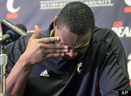 Cincinnati forward Yancy Gates wipes tears from his eyes, Monday, Dec. 12, 2011, at a news conference in Cincinnati where he apologized for his part in a fight that broke out at the end of an NCAA college basketball game between Cincinnati and Xavier, on Saturday. (AP Photo/Al Behrman)