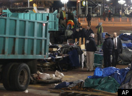 A sanitation worker removes debris from the Occupy Baltimore site after police evicted occupiers from McKeldin Square in Baltimore, Tuesday, Dec. 13, 2011. Baltimore City police moved into McKeldin Square around 3:30 a.m. and closed off surrounding streets.