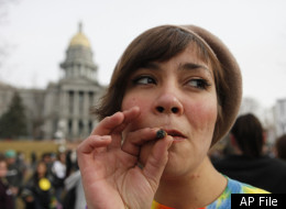 Jenny smokes a marijuana cigarette at a medical marijuana rally at Lincoln Park across from the Capitol in Denver, on Thursday, Jan. 14, 2010. (AP Photo/Ed Andrieski)