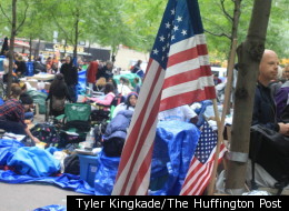 A flag taped to a tree in Zuccotti Park hangs amid Occupy Wall Street protesters, prior to their eviction from the park.