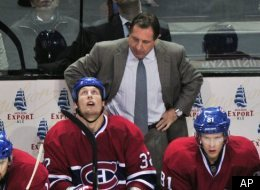 Montreal Canadiens coach Jacques Martin stands behind the bench as they face the Florida Panthers during third period NHL hockey action Monday, October 24, 2011, in Montreal. The Panthers beat the Canadiens 2-1. (AP Photo/Paul Chiasson, The Canadian Press)