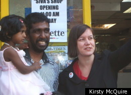 Shopkeeper Siva Kandiah with his daughter and MP Meg Hillier on the day the shop reopened