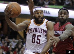 Cleveland Cavaliers' Baron Davis (85) passes around Miami Heat's LeBron James in the second quarter of an NBA basketball game Tuesday, March 29, 2011, in Cleveland. (AP Photo/Mark Duncan)