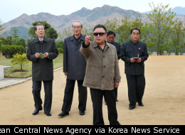 Kim Jong Il inspects a fruit farm in an undated photo released in May 2011.