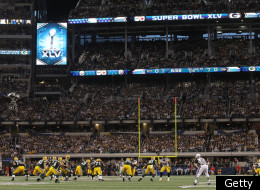 ARLINGTON, TX - FEBRUARY 06: A general view as quarterback Aaron Rodgers #12 of the Green Bay Packers drops back against the Pittsburgh Steelers during Super Bowl XLV at Cowboys Stadium on February 6, 2011 in Arlington, Texas. (Photo by Ronald Martinez/Getty Images)