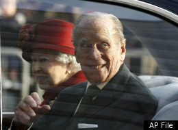 Britain's Queen Elizabeth, left, and Britain's Prince Philip leave following a visit to the Museum of Liverpool in Liverpool, England, Thursday, Dec. 1, 2011. (AP Photo/Tim Hales, Pool)
