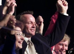 Canadian Alliance Leader Stockwell Day hoists hands with Alliance Member of Parliament Deborah Grey (right) and Candidate Betty Unger following his speech at a rally in Edmonton Alberta Saturday Nov. 25, 2000.