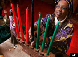 Ruth Ndiagne Dorsey is pictured with a Kwanzaa setting set up for a media photo at her church, The Shrine of the Black Madonna in Atlanta.  (AP Photo/John Amis)
