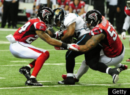 ATLANTA, GA - DECEMBER 15: Maurice Jones-Drew #32 of the Jacksonville Jaguars is tackled by Dominique Franks #24 and John Abraham #55 of the Atlanta Falcons at the Georgia Dome on December 15, 2011 in Atlanta, Georgia. (Photo by Scott Cunningham/Getty Images)