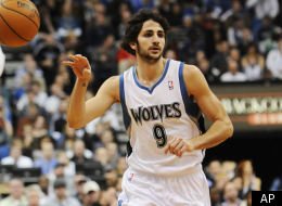 Minnesota Timberwolves' Ricky Rubio of Spain makes a pass as he makes his NBA debut against the Oklahoma City Thunder in the first half of an NBA basketball game Monday, Dec. 26, 2011, in Minneapolis. (AP Photo/Jim Mone)