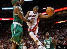 MIAMI, FL - DECEMBER 27: Norris Cole #30 of the Miami Heat drives against Jermaine O'Neal #7 of the Boston Celtics during a game at American Airlines Arena on December 27, 2011 in Miami, Florida.