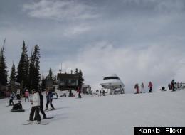 Skiers catch the ski lift at Sunrise Park Resort.