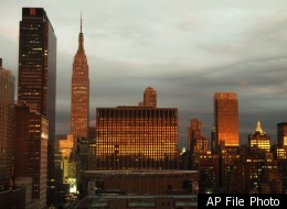 The Empire State Building and Madison Square Garden's rotunda in New York, Thursday, Sept. 15, 2011. The former may soon look prettier on the outside than on the inside, as building cleaners threaten to go on strike.