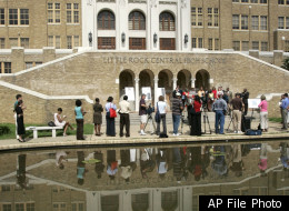 FILE - In this July 16, 2007, file photo, the image of Little Rock Central High School is reflected in a pond during a news conference in Little Rock, Ark. Nine black students desegregated the school in Sept., 1957. An appeals court said Wednsday, Dec. 28, 2011, that Arkansas cannot cut off millions of dollars in funding in Little Rock-area school districts until a challenge to the payments gets a separate federal hearing. (AP Photo/Danny Johnston, File)