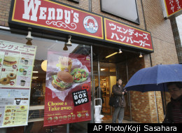 A man walks by a Wendy's hamburger chain restaurant in Tokyo, Japan, Friday, Dec. 11, 2009. The company is coming back to Japan after a two-year absence.