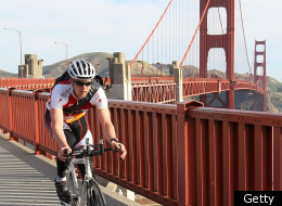 A cyclists rides across the Golden Gate Bridge.