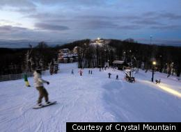 Skiers take advantage of night skiing at Crystal Mountain Resort and Spa.