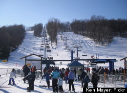 Chairlifts carry skiers and snowboarders up the farside of Liberty Mountain.