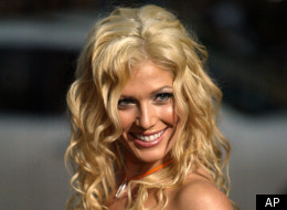 WWE Female wrestling champion and Playboy cover girl Torrie Wilson poses for a photo as she arrives for the world premiere of