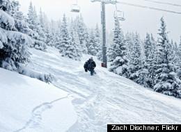 A skier makes his way down the slopes of Vail Ski Resort amidst a heavy snowfall.