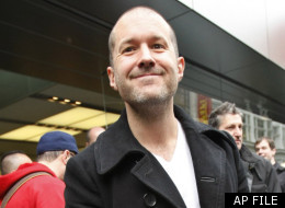 In this April 3, 2010 file photo, Jonathan Ive, Apple senior vice president of industrial design, smiles as he leaves an Apple store on the first day of Apple iPad sales in San Francisco. (AP Photo/Paul Sakuma, File)