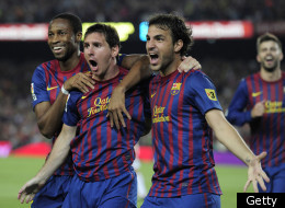 Barcelona's Argentinian forward Lionel Messi (C) is congratulated by his teammates Barcelona's midfielder Cesc Fabregas (R) and Barcelona's Malian midfielder Seydou Keita (L) after scoring during the second leg of the Spanish Supercup football match FC Barcelona vs Real Madrid CF on August 17, 2011 at the Camp Nou stadium in Barcelona. Barcelona won the Spanish Supercup 3-2. AFP PHOTO/ JOSEP LAGO (Photo credit should read JOSEP LAGO/AFP/Getty Images)