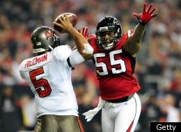 ATLANTA, GA - JANUARY 01: John Abraham #55 of the Atlanta Falcons pressures quarterback Josh Freeman #5 of the Tampa Bay Buccaneers during play at the Georgia Dome on January 1, 2012 in Atlanta, Georgia. (Photo by Grant Halverson/Getty Images)