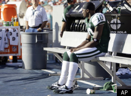 New York Jets wide receiver Santonio Holmes (10) sits alone on the bench in the closing minutes of an NFL football game against the Miami Dolphins, Sunday, Jan. 1, 2012, in Miami. The Dolphins defeated the Jets 19-17. (AP Photo/Lynne Sladky)