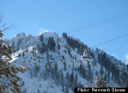 A gondola makes its way past the beautiful Squaw Peak at Squaw Valley USA.