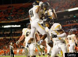 MIAMI GARDENS, FL - JANUARY 04: Shawne Alston #20 and of the West Virginia Mountaineers celebrate after Alston scored 1-yard rushing touchdown in the second quarter against the Clemson Tigers during the Discover Orange Bowl at Sun Life Stadium on January 4, 2012 in Miami Gardens, Florida. (Photo by J. Meric/Getty Images)